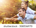 father with daughter outdoors | Shutterstock . vector #508536970
