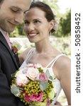 mid adult bride and groom... | Shutterstock . vector #50858452