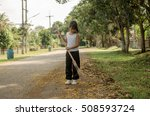 kid cleaning road with broom.... | Shutterstock . vector #508593724