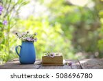flower in blue pot and notebooks | Shutterstock . vector #508696780