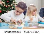family bakes christmas cookies | Shutterstock . vector #508733164