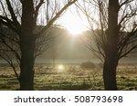 The Sun Rising Behind A Hill A...