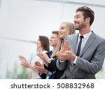 Small photo of Satisfied proud business team clapping hands