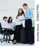 Small photo of Business - meeting in office, two managers are discussing a docu