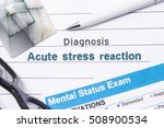 Small photo of Psychiatric Diagnosis Acute Stress Reaction. Medical book or form with the name of diagnosis Acute Stress Reaction is on table of doctor surrounded by questionnaire to determine mental state
