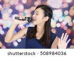 woman singing karaoke | Shutterstock . vector #508984036