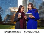 asian woman holding tablet  in... | Shutterstock . vector #509020966