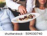 waiter serving a plate of greek ... | Shutterstock . vector #509030740