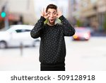 Small photo of young man amazed
