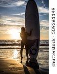girl surfer in black diving...   Shutterstock . vector #509261149