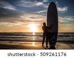 girl surfer in black diving...   Shutterstock . vector #509261176