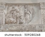Small photo of ROME, ITALY - JANUAR 25, 2015: Relief with the twins and she-wolf and the sacrifice of a Aeneas or Rome's second king, Numa Pompilius