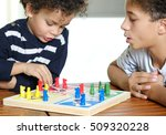 family playing a board game... | Shutterstock . vector #509320228