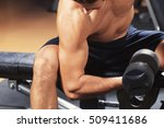 man training with dumbbell in... | Shutterstock . vector #509411686
