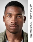 Stock photo portrait of real black african man with no expression id or passport photo full collection of 509414959