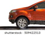 Stock photo orange car with white soap on the body in car care shop isolated on white background 509422513