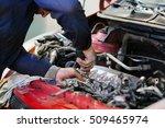 worker repairs a car in a car...   Shutterstock . vector #509465974