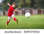 little boy shooting at goal | Shutterstock . vector #509475553