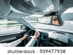 woman drive a car reflects in... | Shutterstock . vector #509477938