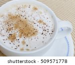 a cup of cappuccino with cocoa...   Shutterstock . vector #509571778