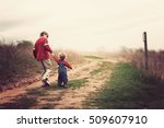 two brothers walking up a hill | Shutterstock . vector #509607910