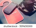 do not disturb sign  a cup of... | Shutterstock . vector #509650300
