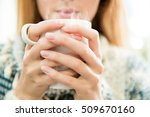 woman holding cup of hot coffee ... | Shutterstock . vector #509670160
