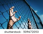 Small photo of the boy holding the cage sky background , imprisoned, retarded, Child Abuse with black shadow