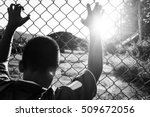 Small photo of the boy holding the cage, imprisoned, retarded, Child Abuse in white tone
