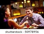 woman spoon feeds her boyfriend ... | Shutterstock . vector #50978956