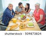happy couple having breakfast... | Shutterstock . vector #509873824