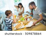 woman cutting loaf of bread... | Shutterstock . vector #509878864