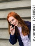 young red woman using her cell... | Shutterstock . vector #509885314
