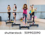 group of women exercising on