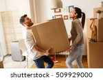 young couple carrying big... | Shutterstock . vector #509929000