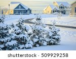 Snow Covered Landscape Of An...