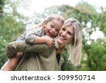 cute young daughter on a piggy... | Shutterstock . vector #509950714