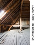 Small photo of attic, wooden beams in old loft / roof before construction