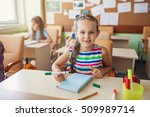 happy children sitting in class ... | Shutterstock . vector #509989714