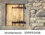 Small photo of Wooden trap door with rusty hinges