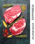 two pieces of raw meat beef on... | Shutterstock . vector #509998834