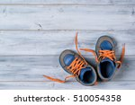 baby autumn shoes on wooden... | Shutterstock . vector #510054358