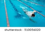 young man swimming freestyle in ... | Shutterstock . vector #510056020