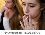 young woman is smoking on the... | Shutterstock . vector #510135778