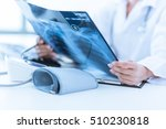 woman doctor looking at x ray... | Shutterstock . vector #510230818