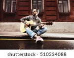Man Plays On Guitar And Sits O...