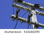 Small photo of Power distribution on concrete pole with surge arresters