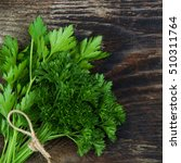fresh parsley on wood background | Shutterstock . vector #510311764