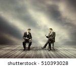 Two Businessman Talking Sittin...