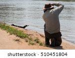 yacare caiman on beach shot by... | Shutterstock . vector #510451804